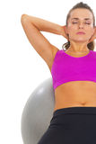 Fitness young woman doing abdominal crunch on fitness ball Stock Photos