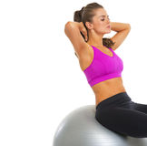 Fitness young woman doing abdominal crunch on fitness ball Stock Image