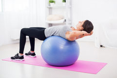 Fitness young woman doing abdominal crunches on Stock Photos