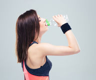 Fitness young woman drinking water Royalty Free Stock Image