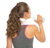 Fitness young woman drinking water . rear view Stock Photography
