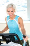 Fitness young woman on elliptical cross trainer Royalty Free Stock Images