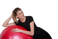 Fitness – Young woman with exercise ball on whit Royalty Free Stock Images