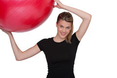 Fitness – Young woman with exercise ball on whit Royalty Free Stock Photos