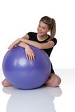 Fitness – Young woman with exercise ball on whit Stock Photography