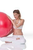 Fitness – Young woman with exercise ball on whit Stock Photo