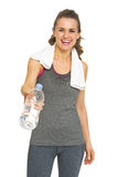 Fitness young woman giving bottle of water Royalty Free Stock Photography