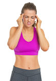 Fitness young woman having headache Stock Photography