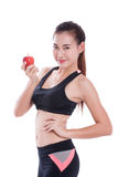 Fitness young woman holding apple Royalty Free Stock Image