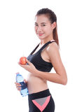 Fitness young woman holding a bottle of water and an apple. Over white background Stock Images