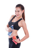 Fitness young woman holding a bottle of water and an apple. Over white background Royalty Free Stock Photography