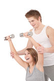 Fitness - Young woman with instructor Royalty Free Stock Images