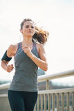Fitness young woman jogging in the city Royalty Free Stock Photo