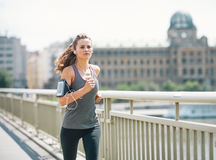 Fitness young woman jogging in the city. Modern fitness young woman jogging in the city royalty free stock photo