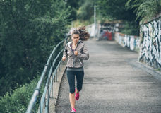 Fitness young woman jogging in the city park Royalty Free Stock Photography