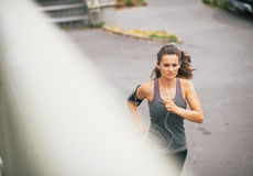 Fitness young woman jogging outdoors in the city Royalty Free Stock Photo