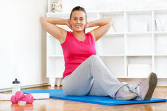 Fitness. Young woman keeping healthy and fit after child birth Royalty Free Stock Photos