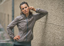 Fitness young woman listening music outdoors Royalty Free Stock Photos