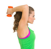 Fitness young woman making exercise with dumbbells Stock Image
