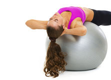Fitness young woman making exercise on fitness ball Royalty Free Stock Photos