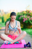 Fitness young woman meditating in the park. Female fitness model training outside in the park. Healthy wellness fitness Royalty Free Stock Photography