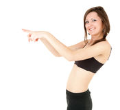 Fitness young woman pointing ahead Royalty Free Stock Images