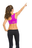 Fitness young woman pointing on copy space Stock Photo