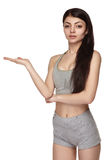 Fitness young woman presenting something Royalty Free Stock Photography
