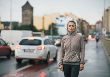 Fitness young woman in rainy city Royalty Free Stock Photo