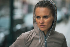 Fitness young woman in rainy city Stock Images