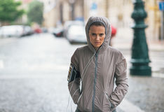 Fitness young woman in rainy city Royalty Free Stock Images