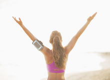 Fitness young woman rejoicing on beach Royalty Free Stock Images