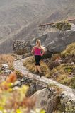Fitness. Young woman running on a mountain road Stock Photos