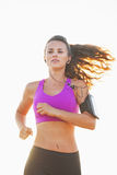 Fitness young woman running outdoors Stock Images