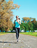 Fitness young woman running in park, female runner workout - sport and healthy lifestyle Royalty Free Stock Photo