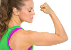 Fitness young woman showing biceps Royalty Free Stock Photos