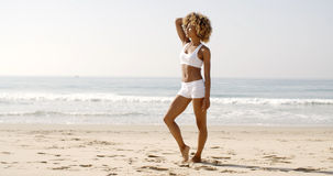 Fitness Young Woman Standing On Beach Stock Photos
