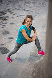 Fitness young woman stretching outdoors Royalty Free Stock Photo