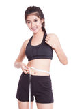 Fitness young woman taking measurements of her body. Royalty Free Stock Photography