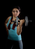 Fitness young woman in training with dumbbells on a black bakground, sporty muscular female brunette. Fitness young woman in training with dumbbells, sporty Stock Image