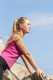 Fitness. Young woman training on mountain road in beautiful nature Stock Photography