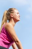 Fitness. Young woman training on mountain road in beautiful nature Royalty Free Stock Photography