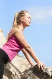 Fitness. Young woman training on mountain road in beautiful nature Stock Photos