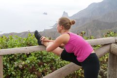 Fitness. Young woman training on mountain road in beautiful nature Royalty Free Stock Images