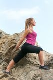 Fitness. Young woman training on mountain road in beautiful nature Stock Images