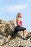 Fitness. Young woman training on mountain road in beautiful nature Royalty Free Stock Photo
