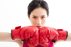 Fitness young woman  wearing red boxing gloves Royalty Free Stock Photography
