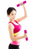 Fitness young woman working out with dumbbells Stock Photo