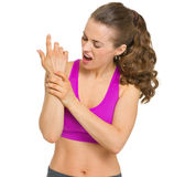 Fitness young woman with wrist pain Royalty Free Stock Images
