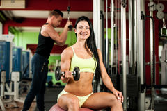 Fitness youple workout - fit mann and woman train in gym stock photo